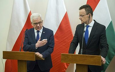 Polish Minister of Foreign Affairs Jacek Czaputowicz, left, and Hungarian Minister of Foreign Affairs and Trade Peter Szijjarto hold a joint press conference at the Minister of Foreign Affairs and Trade in Budapest, Hungary, February 27, 2019. (Zoltan Balogh/MTI via AP)
