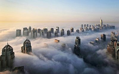 In this Monday, October 5, 2015 photo, a thick blanket of early morning fog partially shrouds the skyscrapers of the Marina and Jumeirah Lake Towers districts of Dubai, United Arab Emirates (AP Photo/Kamran Jebreili)