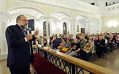 Chief Rabbi of Poland Michael Schudrich, left, who co-wrote the letter of complaint against Israel Katz, seen speaking to visitors in a synagogue in Warsaw in 2015. (AP Photo/Alik Keplicz/File)