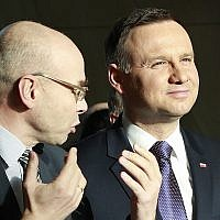 Poland's President Andrzej Duda, right, and Dariusz Stola, the director of the POLIN Museum of the History of Polish Jews, visit the museum in Warsaw, Poland, on Thursday March 3, 2016. (AP Photo/Czarek Sokolowski)