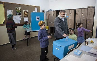 An Israeli votes at the settlement of Efrat on March 17, 2015. (AP Photo/Dan Balilty)