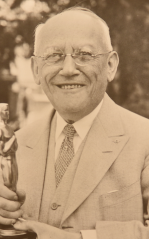Universal Pictures president Carl Laemmle holding an Academy Award for his film 'All Quiet on the Western Front.' (Courtesy James L. Freedman.)