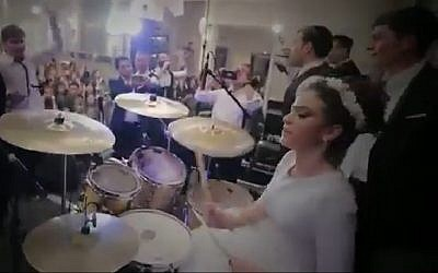 Screen capture from video of bride Shira Hirschkovitz drumming at her own wedding. (YouTube)