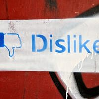 Graffiti on a wall in Jerusalem of a 'dislike' thurmbs-down sign, based on Facebook's thumbs-up 'like' sign. May 26,2011. (Sophie Gordon / Flash 90)
