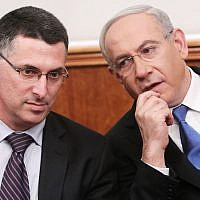 Prime Minister Benjamin Netanyahu, right, and then-interior minister Gideon Sa'ar, left, at the Prime Minister's Office in Jerusalem on December 25, 2012. (Miriam Alster/ Flash90/ File)