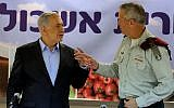 Prime Minister Benjamin Netanyahu, left, and then-IDF chief of staff Benny Gantz at the Eshkol Regional Council in southern Israel, on September 22, 2014. (Edi Israel/Pool/Flash90)