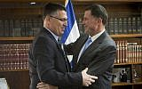 Then-interior minister Gideon Sa'ar (L) seen after handing his official letter of resignation from politics to Knesset speaker Yuli Edelstein, November 3, 2014. (Miriam Alster/Flash90)