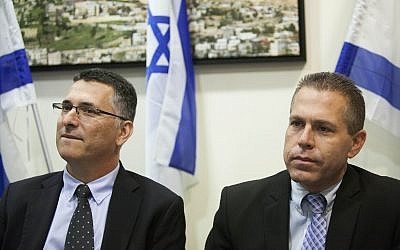 Then-minister of internal affairs Gilad Erdan (R) with outgoing minister Gideon Sa'ar at a ceremony held at the Ministry of Internal Affairs in Jerusalem, November 6, 2014. (Yonatan Sindel/Flash90)