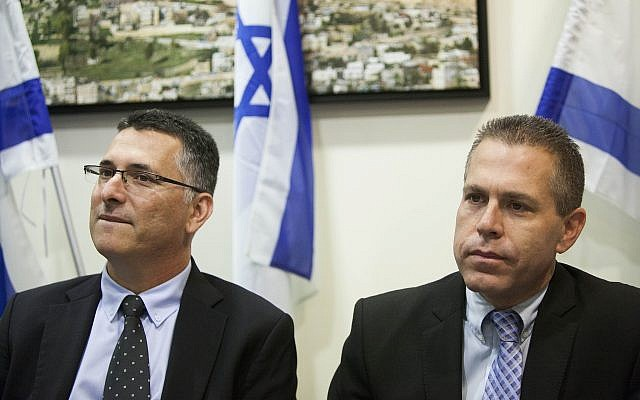 Newly appointed interior minister Gilad Erdan (R) with outgoing minister Gideon Sa'ar at a handover ceremony at the Interior Ministry in Jerusalem, November 6, 2014. (Yonatan Sindel/Flash90)