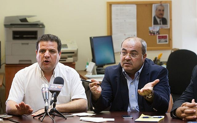 Leader of the Joint Arab list, Ayman Odeh (L) seen with MK Ahmad Tibi at the weekly Joint Arab list meeting at the Knesset, Israel's parliament in Jerusalem on June 29, 2015. (Miriam Alster/Flash90)