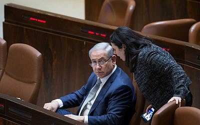 Prime Minister Benjamin Netanyahu (L) speaks with Justice Minister Ayelet Shaked at the Knesset on February 10, 2016. (Yonatan Sindel/Flash90)