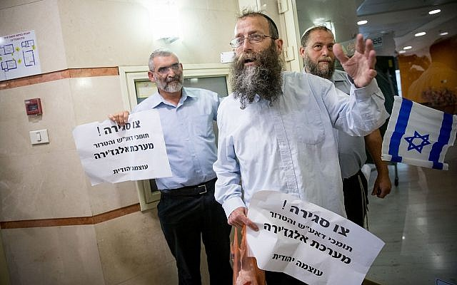 Otzma Yehudit members Michael Ben Ari (L), Baruch Marzel (C) and Benzi Gopstein protest at the entrance to the Al Jazeera offices in Jerusalem on June 13, 2017. (Yonatan Sindel/Flash90)