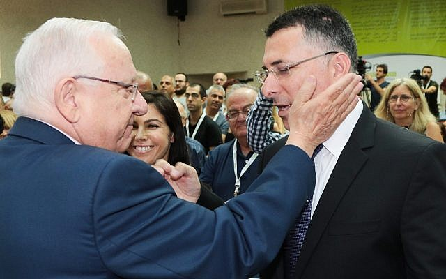 President Reuven Rivlin greets Gideon Sa'ar at a conference in the Tel Aviv suburb of Kiryat Ono, on August 22, 2017. (Roy Alima/Flash90)