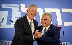 Benny Gantz and Yair Lapid of the newly-formed Blue and White alliance give a joint a statement to the press in Tel Aviv on February 21, 2019. (Noam Revkin Fenton/Flash90)