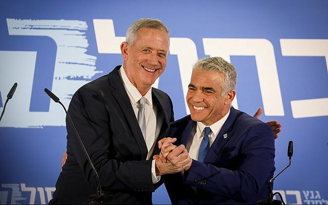 Benny Gantz, left, and Yair Lapid of the newly-formed Blue and White alliance give a joint a statement to the press in Tel Aviv on February 21, 2019. (Noam Revkin Fenton/Flash90)