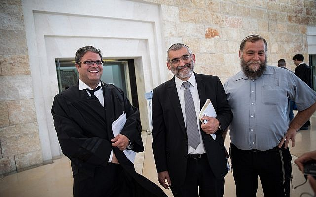 Right-wing activists Michael Ben Ari (center), attorney Itamar Ben Gvir (left), and Bentzi Gopstein at the Supreme Court in Jerusalem on March 12, 2018. (Hadas Parush/Flash90)