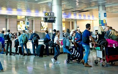 Travelers seen at the arrival hall of Ben Gurion International Airport, near Tel Aviv, on April 11, 2018. (Moshe Shai/FLASH90)