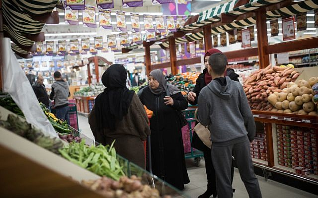 Palestinians shopping at the new Atarot Mall, opened by businessman Rami Levy, owner of the Rami Levy supermarket chain, on January 13, 2019. (Hadas Parush/Flash90)