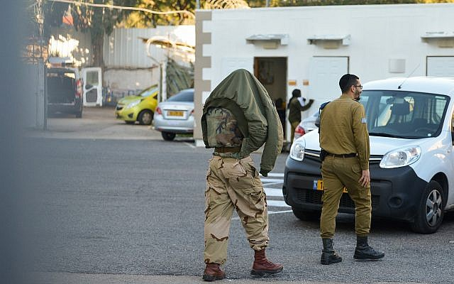 One of the five Netzah Yehuda soldiers convicted of beating two Palestinian detainees arrives for a court hearing at the Jaffa Military Court, on January 10, 2019. (Flash90)