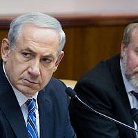 Prime Minister Benjamin Netanyahu (left) and then-cabinet secretary Avichai Mandelblit at a weekly cabinet meeting at the Prime Minister's Office in Jerusalem on February 2, 2014. (Yonatan Sindel/Flash90)