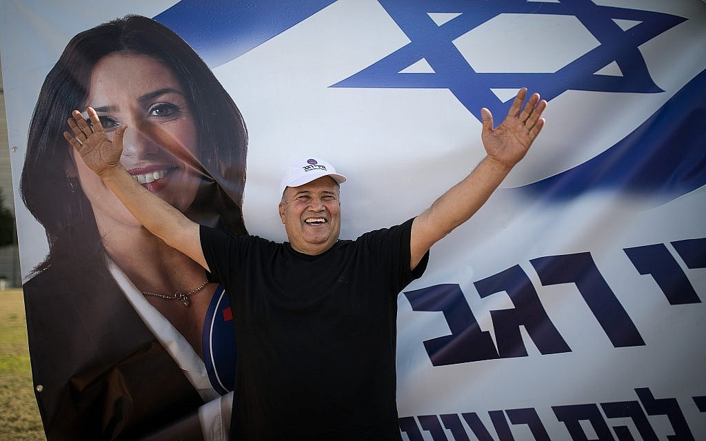 Likud supporters campaign for party members and candidates at the Tel Aviv Likud polling station on February 5, 2019. (Hadas Parush/Flash90)