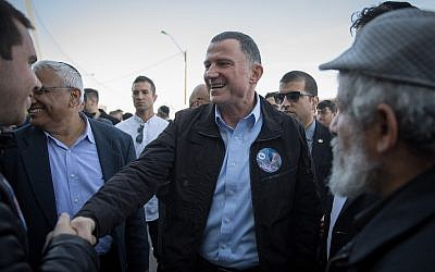 Knesset Chairman Yuli Edelstein seen with supporters outside the Likud polling station in Jerusalem on February 5, 2019 (Noam Revkin Fenton/Flash90)