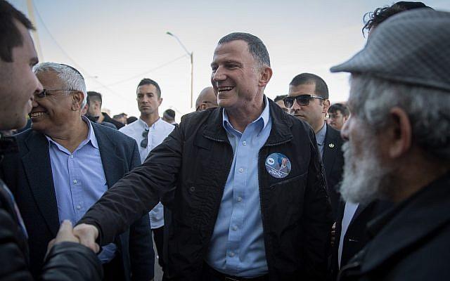Knesset Chairman Yuli Edelstein seen with supporters outside the Likud polling station in Jerusalem on February 5, 2019 (Noam Revkin Fenton/Flash90)