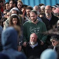 Friends and relatives attend the funeral of Ori Ansbacher, in the Jewish settlement of Tekoa, February 8, 2019 (Yonatan Sindel/Flash90)