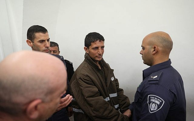 Police escort Arafat Irfaiya , charged with the murder of 19-year-old Ori Ansbacher, at the Jerusalem Magistrate's court, on February 11, 2019. (Yonatan Sindel/Flash90)