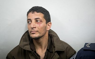 Arafat Irfaiya, charged with the murder of Ori Ansbacher, at the Jerusalem Magistrate's Court on February 11, 2019. (Yonatan Sindel/Flash90)