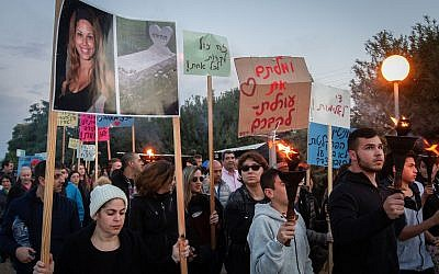 Family and friends of Hila Nagar hold a protest at her grave in Kibbutz Ginnosar, northern Israel on February 17, 2019. (Flash90)