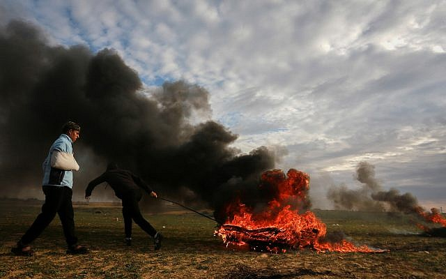 Palestinian protesters during clashes with Israeli forces along the border with Israel, east of Rafah in the southern Gaza Strip, on February 22, 2019. (Abed Rahim Khatib/ Flash90)