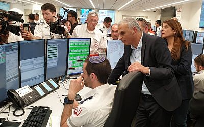 Finance Minister Moshe Kahlon, right,  at the dedication ceremony for a new Magen David Adom emergency services dispatch center which is protected against missile, chemical, and biological attacks, February 25, 2019. (MDA spokesperson)