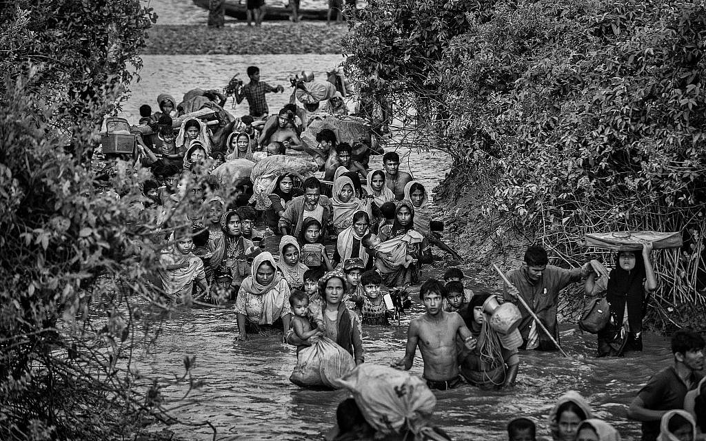 Rohingya Muslim refugees crowd a canal as they flee over the border from Myanmar into Bangladesh, November 1, 2017. (Kevin Frayer/Getty Images/via JTA)