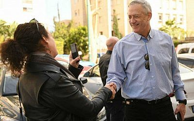 Israel Resilience's Benny Gantz speaking to a Times of Israel journalist while campaigning in Tel Aviv, February 1, 2019 (Sraya Diamant/Israel Resilience)