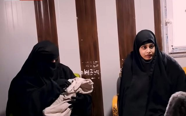 Screen capture from video of an interview with Shamima Begum, right, a British teen who joined the Islamic State. Her newborn baby is held by a woman, left, during the interview from Syria, February 2019. (YouTube)