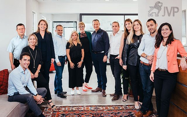 The investment team of Jerusalem Venture Partners (JVP) with founder Erel Margalit at the center in a blue shirt (Courtesy)