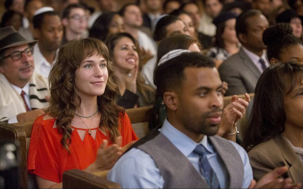 Tara, played by Lola Kirke, in synagogue in the new film 'Untogether.' (Courtesy Freestyle Digital Releasing)