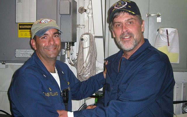 The US Navy released this picture on April 12, 2009 of Maersk-Alabama Capt. Richard Phillips, right, standing alongside Cmdr. Frank Castellano, commanding officer of the USS Bainbridge (DDG 96) after being rescued by US Naval Forces off the coast of Somalia. (Official U.S. Navy photo)