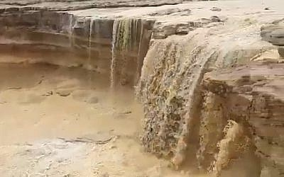 Screen capture from video of rainwater flooding into the Ramon Crater in the southern Negev region, February 7, 2019. (Twitter)