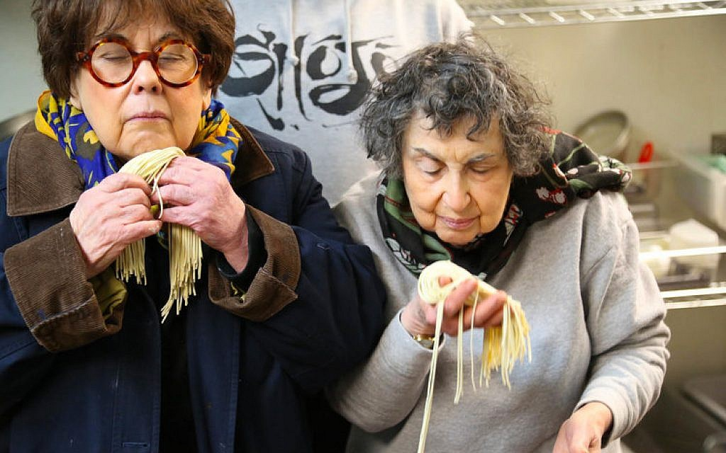 Marilynn (left) and Sheila Brass learn how to make ramen noodles at Shojo restaurant in Boston's Chinatown. (Bruce Seidel)