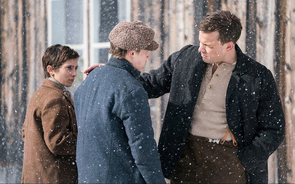In the new historical dramatic film 'The Bird Catcher', a Norwegian Jewish girl named Esther (Sarah-Sofie Boussnina) poses as a non-Jewish boy named Ola to survive on a country farm with the Dalgaard family during WWII. Ola, at left, appears in a scene with two members of the family: Aksel (Arthur Hakalahti), center, who knows her secret; and Uncle Fred (Johannes Kuhnke), right. (Courtesy)