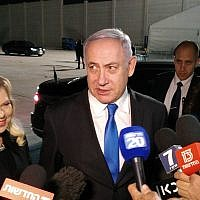Prime Minister Benjamin Netanyahu speaking with reporters at Ben Gurion Airport before his departure to a conference in Poland, February 11, 2019. (Raphael Ahren/Times of Israel)