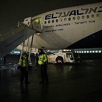 Flight crew stand in front of Prime Minister Benjamin Netanyahu's damaged plane on February 15, 2019. (Raphael Ahren/Times of Israel)