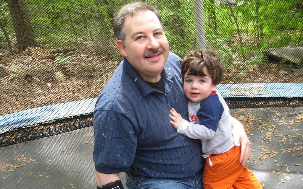 Lenny Pozner with his son Noah. (Courtesy)