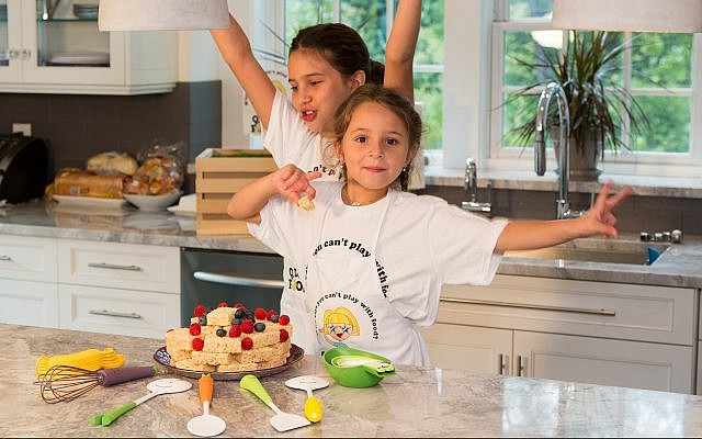 Kids cooking with Q.D. Foodie kitchen tools. (Courtesy Q.D. Foodie)