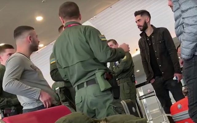 A group of detained Israelis speak with Ukrainian security guards at Kiev Boryspil International Airport on February 2018, 2019. (Screen capture: YouTube)