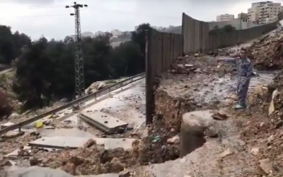 A section of the security barrier around the West Bank village of Anata near Jerusalem that collapsed after a rainstorm on February 27, 2019. (Screen capture)