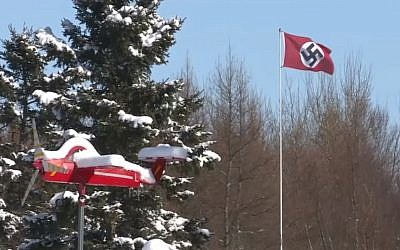 Screen capture of a swastika flag displayed on a pole in Charlottetown, Prince Edward Island, Canada, February 2019. (YouTube)