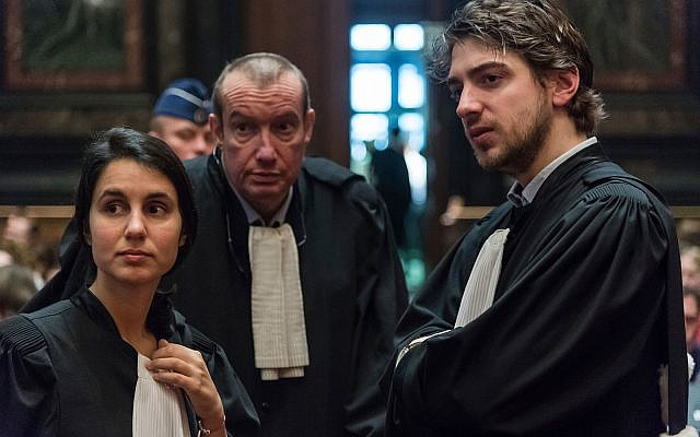 Lawyers Aurelia Psalti, left, Christian Dalne, center, and Guillaume Lys attend the trial of Mehdi Nemmouche at the Justice Palace in Brussels, Thursday, Feb. 28, 2019. (AP Photo/Geert Vanden Wijngaert, Pool)